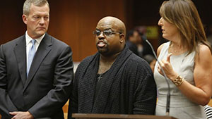 "Grammy Award winning singer and ""The Voice"" TV judge CeeLo Green (C), stands with his attorneys after being charged with one count of furnishing a controlled substance. (REUTERS/Mel Melcon/The Los Angeles Times/Pool)"